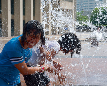 071612, Boston, MA - Arianna Ortiz-Dixon, 12, left, and JCarina Thompson, 13, right, cool off in the splash fountain at Christian Science Plaza. Herald photo by Ryan Hutton