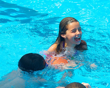 071612, Boston, MA - Natalie Rubin, 9, plays with Thomas Garity, 8, in the North End's Mirabella Pool to stay cool on Monday. Herald photo by Ryan Hutton