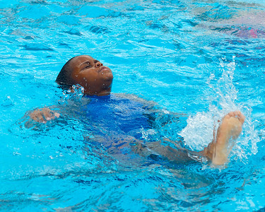 071612, Boston, MA - Eki Imudia, 6, practices his back stroke in the North End's Mirabella Pool to stay cool on Monday. Eki says he wants to be an Olympic swimming when he's older. Herald photo by Ryan Hutton