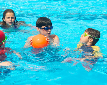 071612, Boston, MA -Thomas Garity, center, plays with Chase and Natalie Rubin in the North End's Mirabella Pool in an attempt to stay cool on Monday. Herald photo by Ryan Hutton
