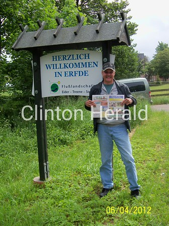 """Rick Michaelsen, Clinton native, visiting Germany recently visited the city of Erfde, which is Clinton's sister city. Did not have a Clinton Herald with me, so I picked up a local newspaper to pose with instead.  If this picture and caption makes the Herald, I'm supposed to say """"Hi"""" to Mike Kearney from Jan-Hermann Dau, who snapped this picture! ;-) <br /> <br /> Photographer's Name: Rick Michaelsen<br /> Photographer's City and State: Keokuk, IA"""