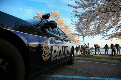 A U.S. Park Police vehicle sits parked at the Tidal Basin on the National Mall in Washington, D.C. on March 30, 2021, as crowds descend to see Cherry Blossom trees that have reached peak bloom. Authorities have said that they will close the area if crowds become too large, due to continued concerns over the spread of COVID-19.