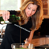 Shereen Pavlides of Voorhees, N.J., demonstrates cooking skills in her kitchen as she prepares a tilapia dish with sriracha remoulade. Pavlides has a cooking blog called Shereen's Tweet-N-Eats, where she shares recipes, cooking ideas, and various other helpful food and entertainment tips.