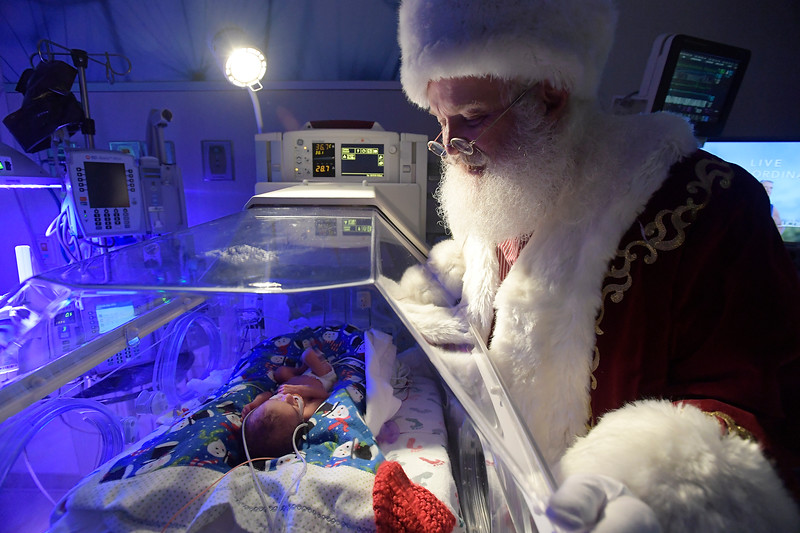 Santa looks into the incubator at three-day-old Trent Payne in the neonatal intensive care unit at Poudre Valley Hospital in Fort Collins, Colo. on Tuesday, Dec. 17, 2019.