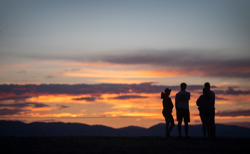 People watch the sunset before the fireworks display at The Ranch Event Complex in Loveland, Colo. on Saturday, July 4, 2020.
