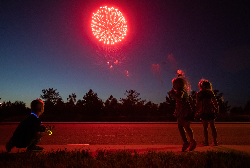 Children jump and shout during the fireworks show at The Ranch events complex in Loveland, Colo. on Sunday, July 4, 2021.
