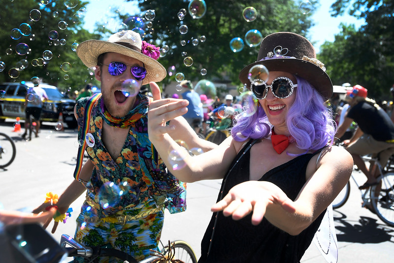 Caitlin Bosshart, right, and Jake Whipple dance in bubbles during the Tour de Fat bike parade, part of New Belgium Brewing's annual bike festival, in downtown Fort Collins, Colo. on Saturday, Aug. 31, 2019.