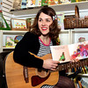 Larissa (Lolly) Hopwood and her band, the Let's Play Today Bunch, entertain children at appearances throughout the area. Hopwood recently spent a morning at the Doylestown Bookstore, where she read stories, played sing-along songs on her guitar, and led children in a coloring activity.
