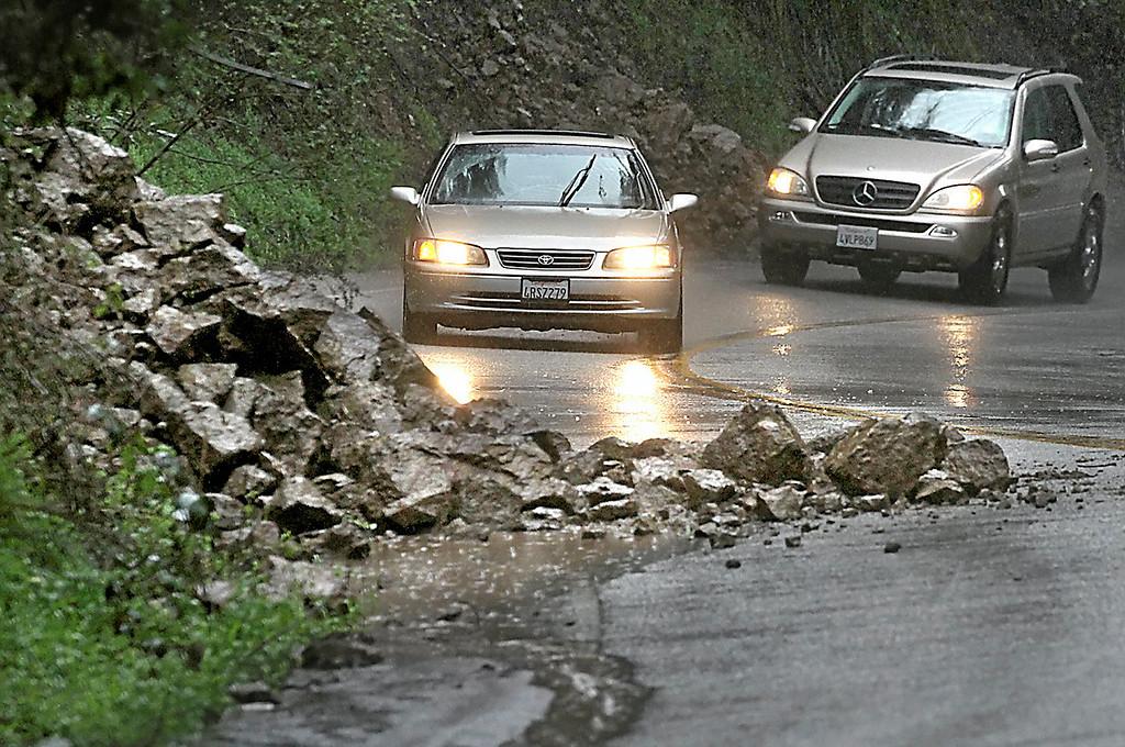 . Debris from a slide partially blocks Old San Jose Road Thursday afternoon. (Shmuel Thaler -- Santa Cruz Sentinel)
