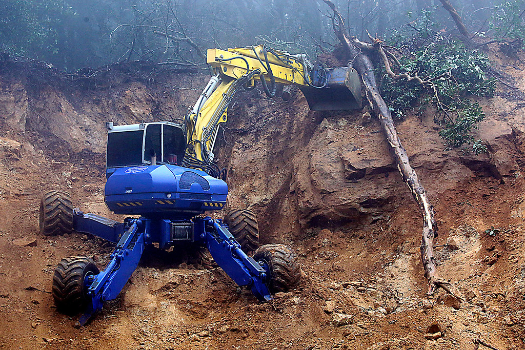. A spider excavator is used to repair the Highway 17 slide Wednesday. (Shmuel Thaler -- Santa Cruz Sentinel)