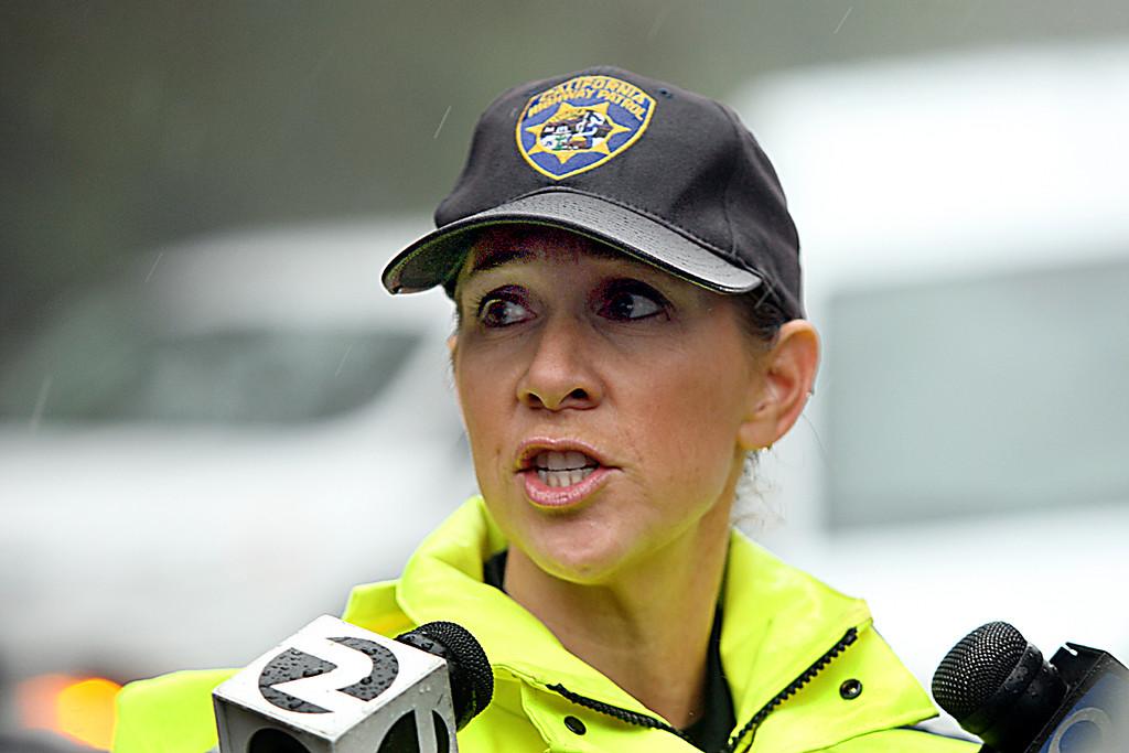 . California Highway Patrol officer Trista Drake provides information about the Graniterock worker killed Thursday morning at the Highway 17 mudslide repair work site.  (Dan Coyro -- Santa Cruz Sentinel)