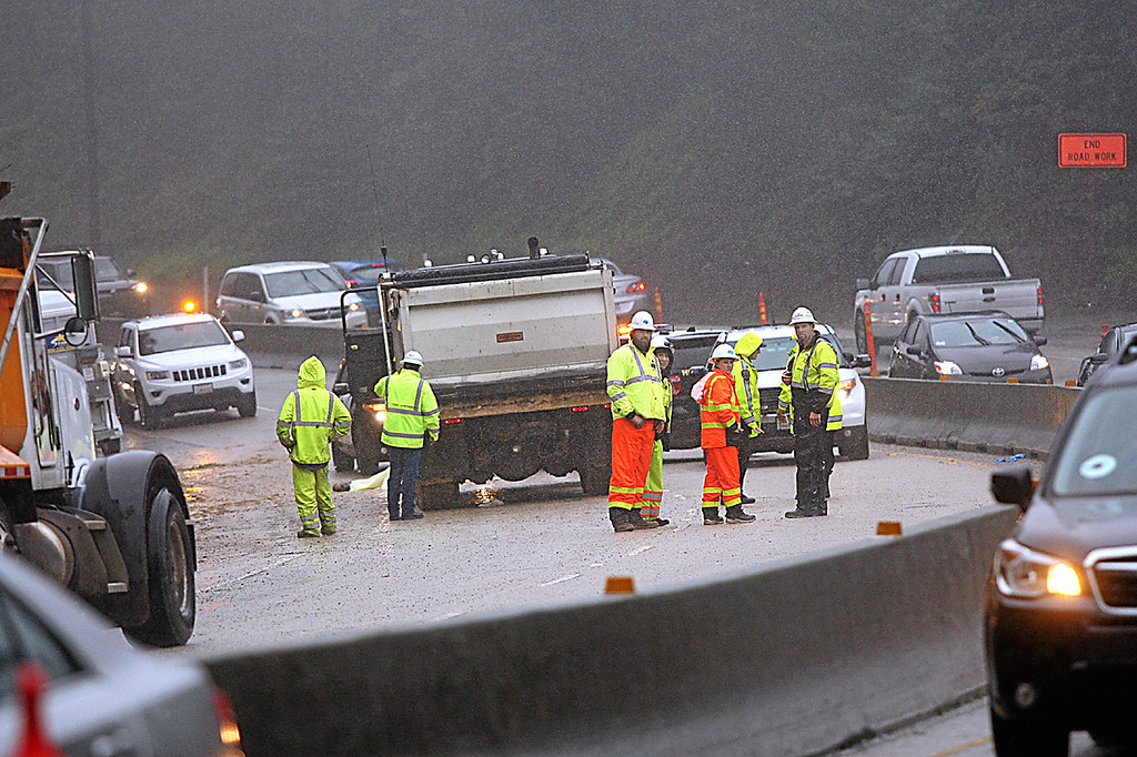 . A Graniterock contract worker at the Highway 17 mudslide worksite was killed Thursday and another injured when the dump truck, at center, struck both workers on the jobsite.  (Dan Coyro -- Santa Cruz Sentinel)