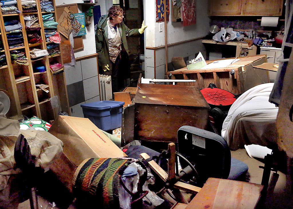 . Rose Morisoli spends Wednesday cleaning up the devastation left by Tuesday\'s San Lorenzo River flooding to her ground floor quilting studio in her Felton Grove home. (Shmuel Thaler -- Santa Cruz Sentinel)