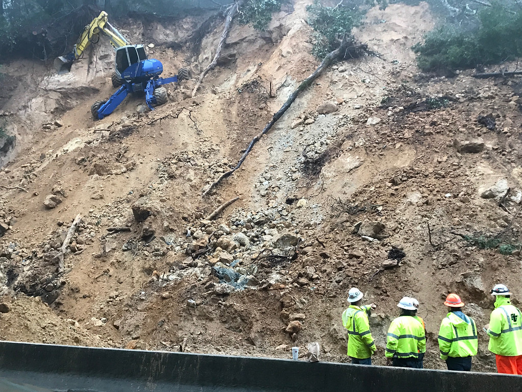 . Caltrans\' \'Spider\' works to stabilize a hillside near Highway 17 on Wednesday. (Shmuel Thaler -- The Sentinel)