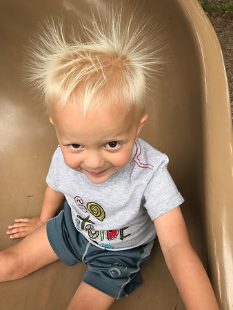 "The true ""electric slide"" taken by Jocelyn Brett, 325 White Oak Lane, Johnstown, Pa 15904. 814-243-3388.  This is my grandson Beau enjoying a slide at the Boise St. playground this past summer.  He was a little concerned that his hair would stay like this and kept asking me all day, ""Is my hair down yet?"""