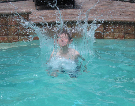 Please accept this picture for this weeks contest with theme of people/ family.<br /> It is one of my oldest grandson, Adam, last May while visiting with our son's family in Florida.<br /> The kids were swimming in their pool and wanted me to take some action shots.<br />  He must have jumped into the pool at least 50 times to get this shot of the water splash surrounding him.<br /> It was taken with my Canon Rebel T6i camera.<br />  <br />  <br /> Thank you<br /> Judy Petrusic<br /> 121 Honeysuckle Lane<br /> Windber, PA 15963 (Richland)<br /> 814-242-7160