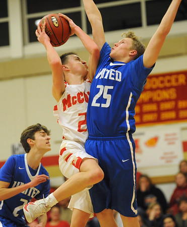Bishop McCort's Ben Seidel, left, tries shooting over United's Austin Kovalcik during a PIAA District 6, Class AA playoff game in Johnstown, PA., Thursday, Feb.22, 2018.