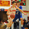 Bishop McCort's Ben Seidel, left, drives past United's Alex Ringler during a PIAA District 6, Class AA playoff game in Johnstown, PA., Thursday, Feb.22, 2018.