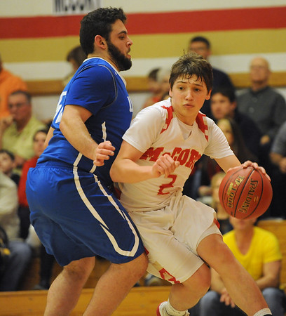 Bishop McCort's Luke Conahan, right, takes the baseline around United's Nate Fabrizio during a PIAA District 6, Class AA playoff game in Johnstown, PA., Thursday, Feb.22, 2018.