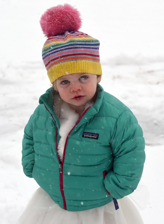 . Kinsley Callahan, 2, catches snowflakes on her eyelashes at  Mapleton School during a February 10th snow in Boulder. Cliff Grassmick  Photographer  February 10, 2018
