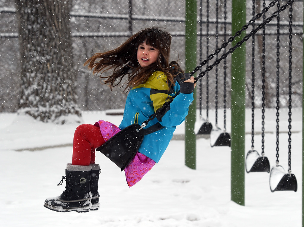 . India Williams, 8, tries out the swing at  Mapleton School during a February 10th snow in Boulder. Cliff Grassmick  Photographer  February 10, 2018