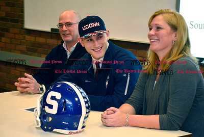 2/3/2016 Mike Orazzi | Staff Southington High School's Jasen Rose while signing his letter on intent to attend UConn Wednesday afternoon.