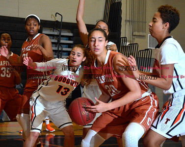 2/2/2016 Mike Orazzi | Staff Goodwin Tech's Paola Barbosa (13)  and Capital Prep's Angelique Rodriguez (20) in New Britain Tuesday night.