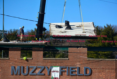 2/2/2016 Mike Orazzi | Staff Crews remove a section of the roof behind home plate as part of the $1.5 million second phase of improvements  at Muzzy Field in Bristol Tuesday. Improvements include putting a new press box behind home plate, extending the roof over the first baseline grandstand and a new sign with the name of the park.