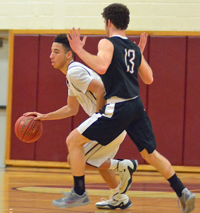 KYLE MENNIG - ONEIDA DAILY DISPATCH Canastota's Zarin Martin (25) brings the ball up the court as Clinton's Ben Glindmyer (13) defends during their game in Canastota on Friday, Feb. 3, 2017.