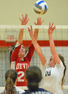 KYLE MENNIG - ONEIDA DAILY DISPATCH Whitesboro's Erin Herrmann (10) sets the ball as Vernon-Verona-Sherrill's Sarah Wayland-Smith (23) jumps to block during their match in Verona on Thursday, Feb. 2, 2017.