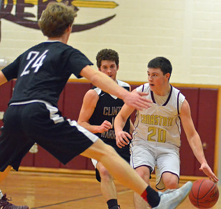 KYLE MENNIG - ONEIDA DAILY DISPATCH Canastota's Jeff Marsh (20) brings the ball up the court as Clinton's Ben Glindmyer (13) and Fritz Gale (24) defend during their game in Canastota on Friday, Feb. 3, 2017.