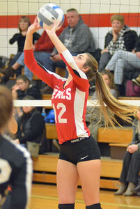 KYLE MENNIG - ONEIDA DAILY DISPATCH Vernon-Verona-Sherrill's Gracie Winn (12) sets the ball during a match against Whitesboro in Verona on Thursday, Feb. 2, 2017.