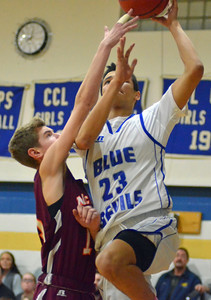 KYLE MENNIG - ONEIDA DAILY DISPATCH Madison's Sam Matteson (23) puts up a shot inside over a McGraw defender during their game in Madison on Tuesday, Feb. 7, 2017.