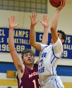 KYLE MENNIG - ONEIDA DAILY DISPATCH Madison's Sam Matteson (23) takes a shot as McGraw's Spencer Welsh (15) defends during their game in Madison on Tuesday, Feb. 7, 2017.