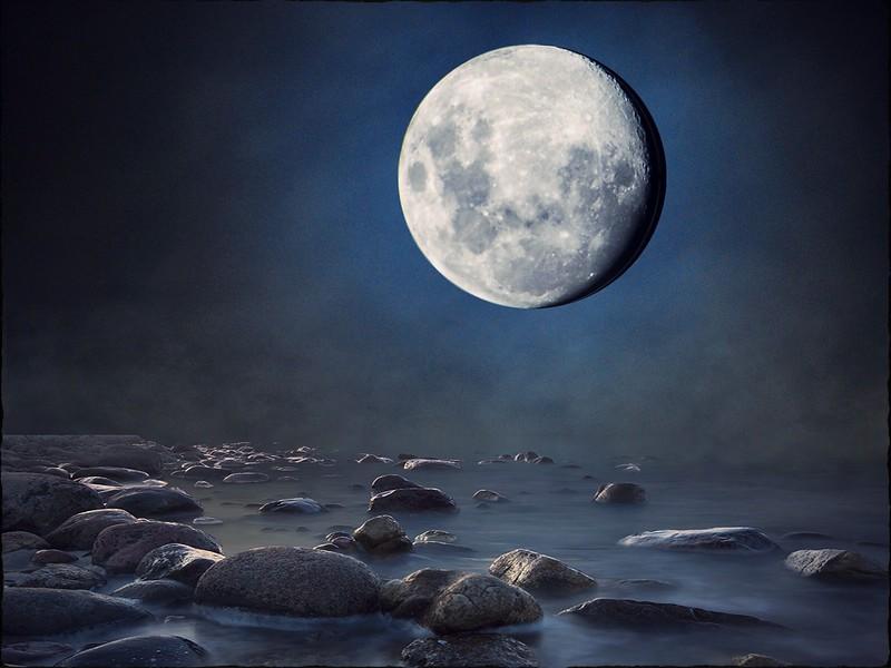 """Moon Over Rocky Shore."""
