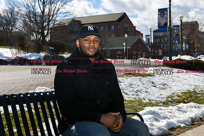 020217 Wesley Bunnell | Staff  CCSU student Lamar Bowsky sits outside of the student center on Thursday Feb 2.