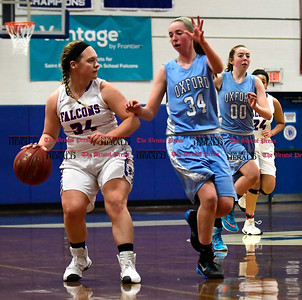 2/3/2017 Mike Orazzi | Staff St. Paul's Alexa Morneault (34) and Oxford's Molly Smith (34) Friday night.