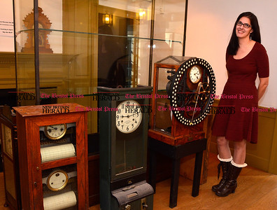 2/3/2017 Mike Orazzi | Staff Patti Philippon, Executive Director at American Clock & Watch Museum, next to a time punch clock on Friday.