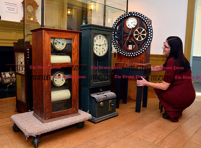 2/3/2017 Mike Orazzi | Staff Patti Philippon, Executive Director at American Clock & Watch Museum, moves a time punch clock on Friday.
