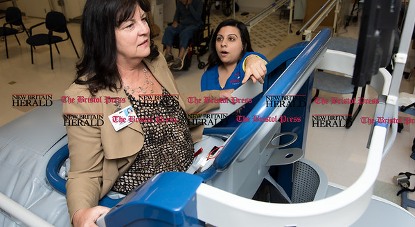020617  Wesley Bunnell | Staff  Terry Jones of Autumn Lake Healthcare at New Britain receives instruction in using the  AlterG Anti Gravity Treadmill with the help of Anna Patel. The treadmill is a speciality piece of equipment the facility offers which assists in a faster rehabilitation.