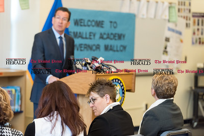 020617  Wesley Bunnell | Staff  New Britain Superintendent Nancy Sarra, middle seated, is shown during Governor Dannel P. Malloy's news conference at Smalley Academy in New Britain on Monday afternoon to discuss his upcoming budget proposal.