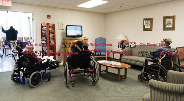 020617  Wesley Bunnell | Staff  Patients watch tv in a common area at the short term rehabilitation unit at Autumn Lake Healthcare at New Britain .