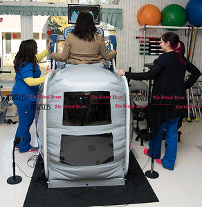 020617  Wesley Bunnell | Staff  Terry Jones of Autumn Lake Healthcare at New Britain gets set up to demonstrate the AlterG Anti Gravity Treadmill with the help of Anna Patel, left, and Erin Lafratta. The treadmill is a speciality piece of equipment the facility offers which assists in a faster rehabilitation.