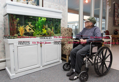 020617  Wesley Bunnell | Staff  Harry Ciandella spends time at the fish tank inside of a common area at the Autumn Lake Healthcare facility at New Britain.