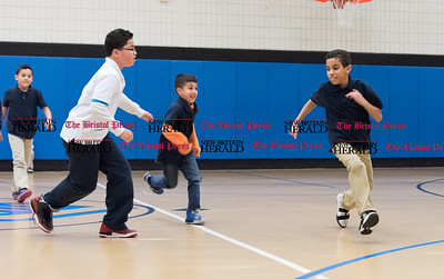 020717  Wesley Bunnell | Staff  Playing a game of wall in the Boys and Girls Club of New Britain on Tuesday February 7 are 10 year old Jonathan Villa, second from the left, Pryce Garcia, age 6 and 10 year old Victor Valle.
