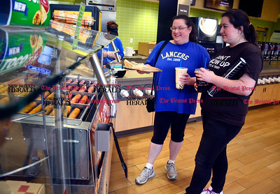 3/31/2016 Mike Orazzi | Staff Tabitha Robinson and her daughter Trinette while at the grand opening event to celebrate Cumberland Farms' new store at 1978 West Street in Southington