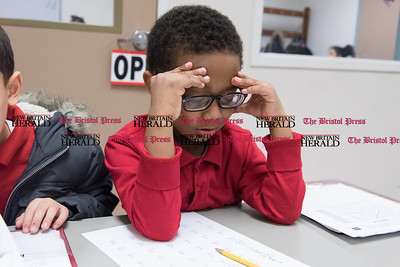 020717  Wesley Bunnell | Staff  Seven year old Julian Vasquez concentrates on his math assignments in the Learning Center of the Boys and Girls Club of New Britain on Tuesday February 7.