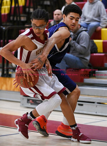 020717  Wesley Bunnell | Staff  New Britain boys basketball vs Middletown on Tuesday February 7 at New Britain High School. Isaiah Jenkins (4) spins around a defender.