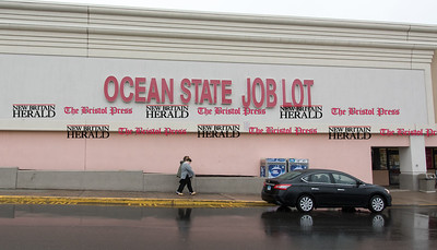 020717  Wesley Bunnell | Staff  Cars wait for customers on a rainy day outside Ocean State Job Lot on Tuesday Feb 7.
