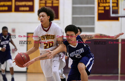 020717  Wesley Bunnell | Staff  New Britain boys basketball vs Middletown on Tuesday February 7 at New Britain High School. Maurice Turner (20) avoids the reach in from a Middletown defender.